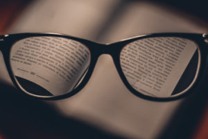 Decorative photo of glasses and text