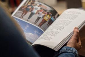 Decorative image of person reading publication