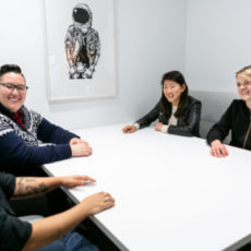 Decorative photo of group sitting around table
