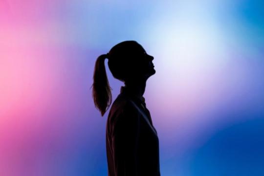Decorative photo of person's silhouette against multi-coloured background