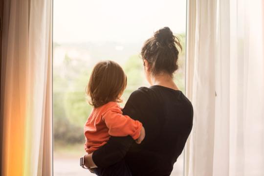 Decorative photo of parent with child